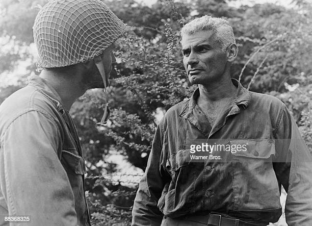 American actor Jeff Chandler as Brigadier General Frank D Merrill and Ty Hardin as 2nd Lieutenant Lee Stockton in a scene from the film 'Merrill's...