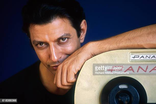 American actor Jeff Goldblum poses with filming equipment in France He is starring in the 1990 French and British film Mister Frost directed by...