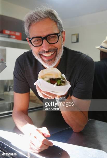 American Actor Jeff Goldblum serves sausages to customers at Wynard Park / Circular Quay on April 26 2017 in Sydney Australia
