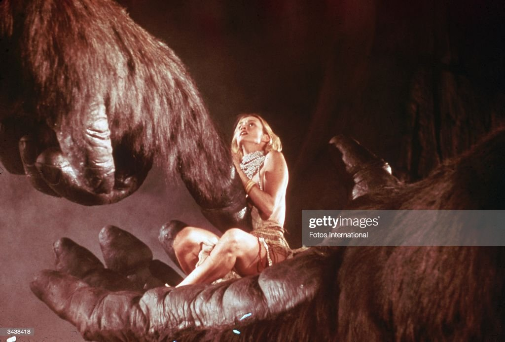 American actor Jessica Lange sits in the hand of a giant gorilla in a still from the film, 'King Kong,' directed by John Guillermin.