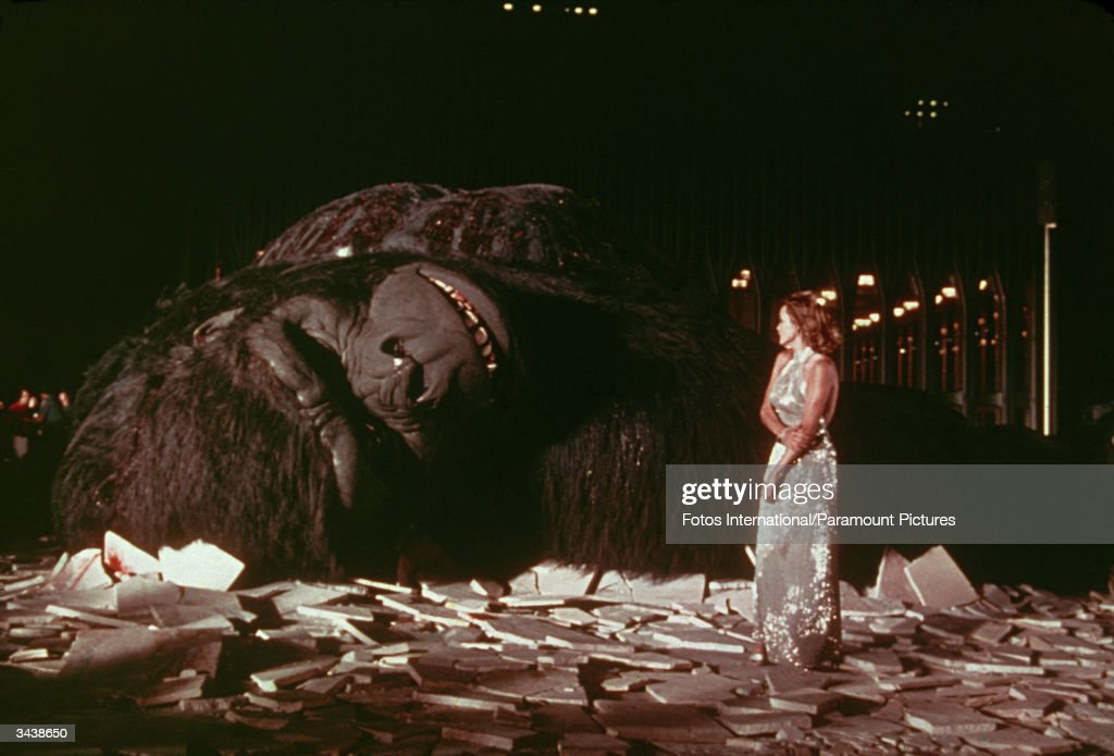 American actor Jessica Lange stands in a pile of debris near the fallen giant gorilla in a still from the film, 'King Kong,' directed by John Guillerman.