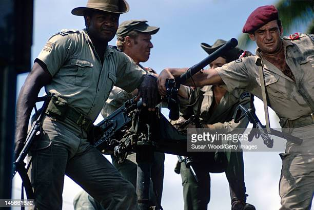 American actor Jim Brown German actor Peter Carsten and Australian actor Rod Taylor pose in costume on the set of the film 'Dark of the Sun' Jamaica...