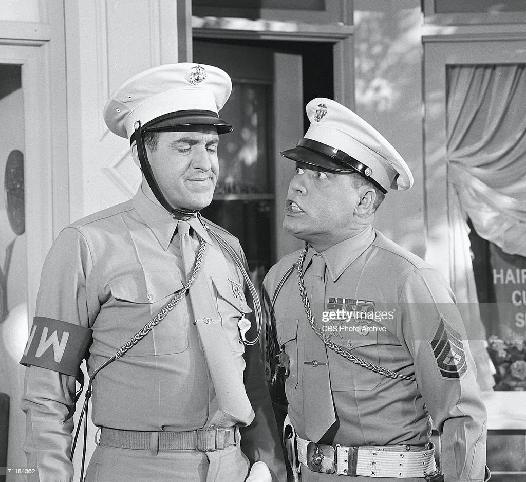 American actor Jim Nabors (left) grimaces as fellow actor Frank Sutton (1923 - 1974) trembles with anger in an episode of the television comedy series 'Gomer Pyle, USMC' called 'Gomer, M.P,' February 10, 1965.