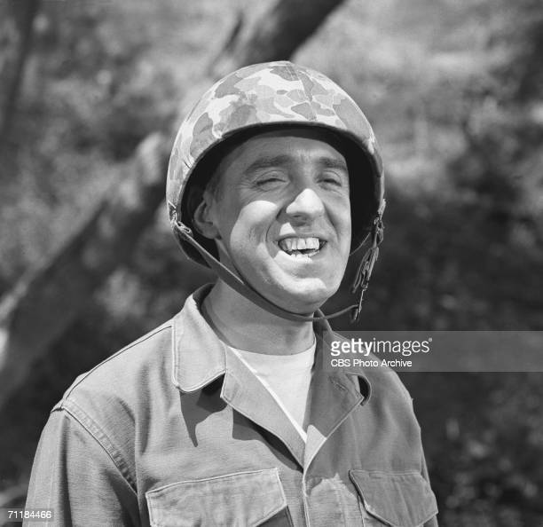 American actor Jim Nabors smiles while wearing an illfitting camouflage helmet in an episode of the television comedy series 'Gomer Pyle USMC' called...