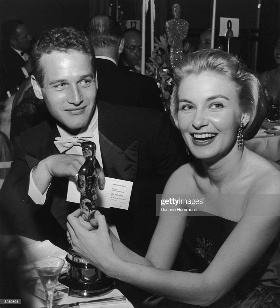 American actor Joanne Woodward holds her Oscar statuette while sitting next to husband, American actor Paul Newman, during the Governor's Ball, an Academy Awards party held at The Beverly Hilton Hotel, Beverly Hills, California. Woodward won the Best Actress Oscar for director Nunnally Johnson's, 'The Three Faces of Eve.'