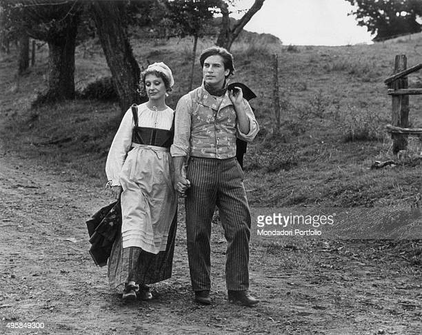American actor Joe Dallesandro and Italian actress Adriana Asti walking hand in hand in the film A Simple Heart Italy 1976