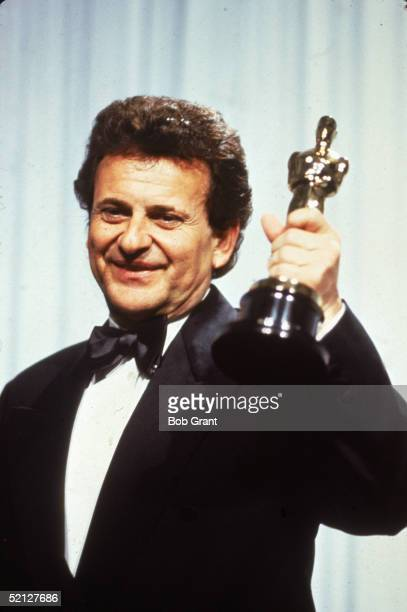 American actor Joe Pesci smiles as he holds up his Oscar for Best Supporting Actor for his role in 'Goodfellas' at the 63rd Annual Academy Awards...