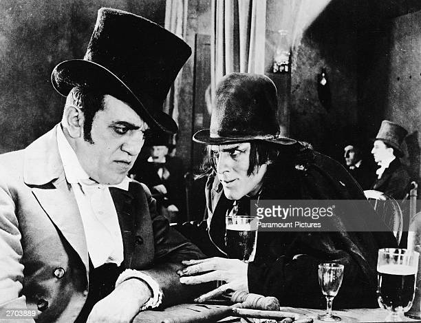 American actor John Barrymore as Mr Hyde touches the arm of an unidentified actor at a bar in a still from director John S Robertson's film 'Dr...
