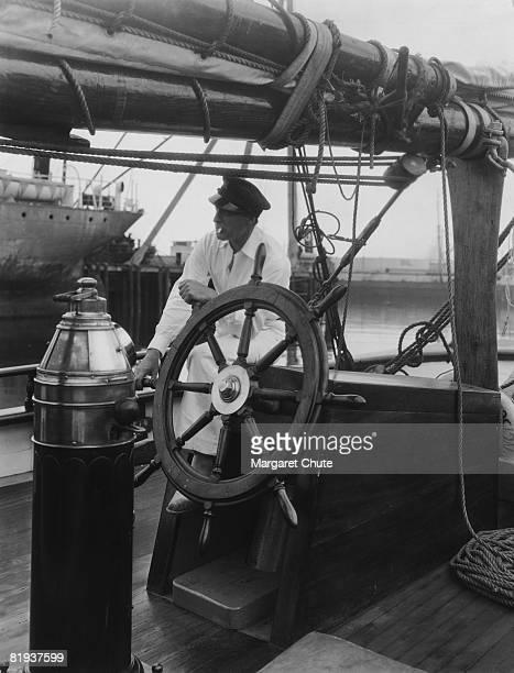 American actor John Barrymore at the wheel of his yacht 'Infanta' circa 1930