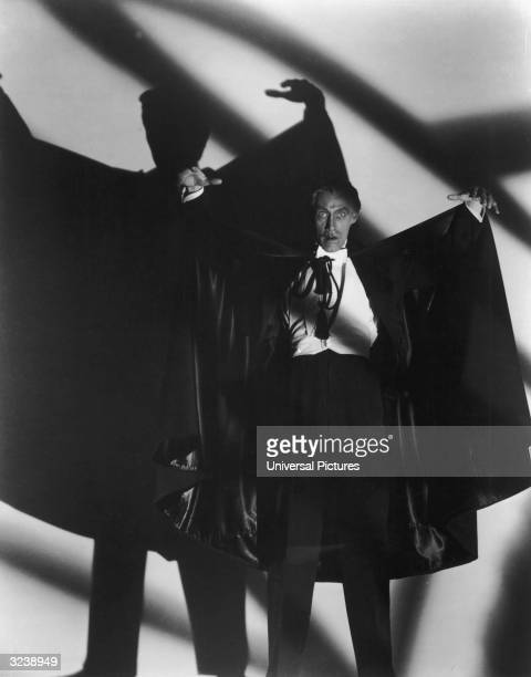 American actor John Carradine poses with his arms raised as Count Dracula in a promotional still for director Earle C Kenton's film 'The House of...