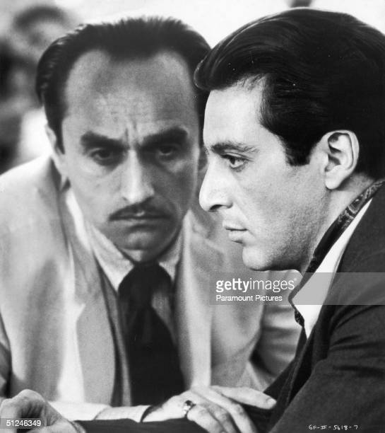 1974 American actor John Cazale puts his hand on the arm of American actor Al Pacino in a still from director Francis Ford Coppola's film 'The...