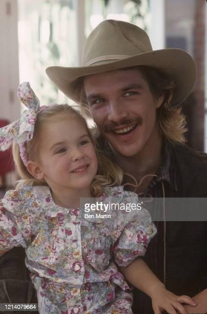 American actor John Clark Gable, and daughter Kayley, February 1984.