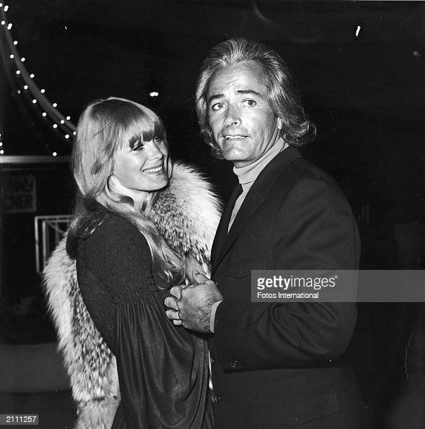American actor John Derek and his third wife American actor Linda Evans attend a Sonny and Cher opening at Century Plaza Hotel Los Angeles California...