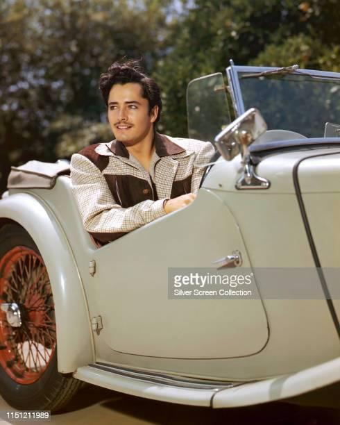 American actor John Derek at the wheel of his MG TC Roadster circa 1950