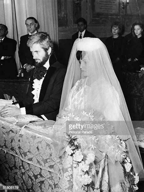 American actor John Drew Barrymore and his second wife Gaby Palazzolo kneel before the altar during their wedding ceremony 1960 Barrymore was the son...