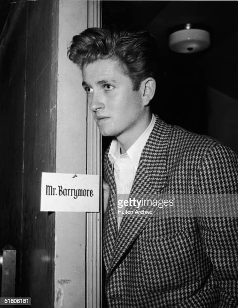 American actor John Drew Barrymore looks through the doorway of his dressing room early 1950s Barrymore was the son of American actor John Barrymore...