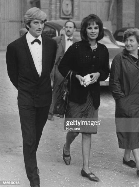 American actor John Drew Barrymore walking in the studio gardens with actress Antonella Lualdi during the filming of 'Sexy Party' later titled...