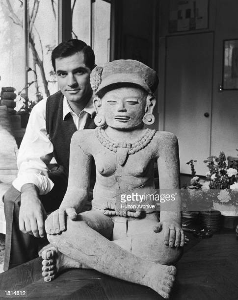American actor John Gavin poses with a figure that dates from 800 A.D. From his private collection, May 6, 1962. Fluent in Spanish and Portuguese,...