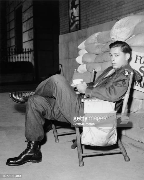 American actor John Kerr on the set of the MGM film 'Gaby' 1955 He plays a World War II corporal in the film which is based on the play 'Waterloo...