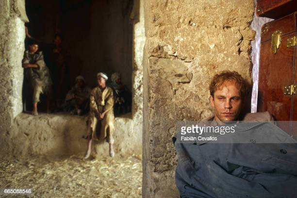 American actor John Malkovitch leans against a wall during the shooting of the movie Un The au Sahara or Il Te Nel Deserto originally The Sheltering...