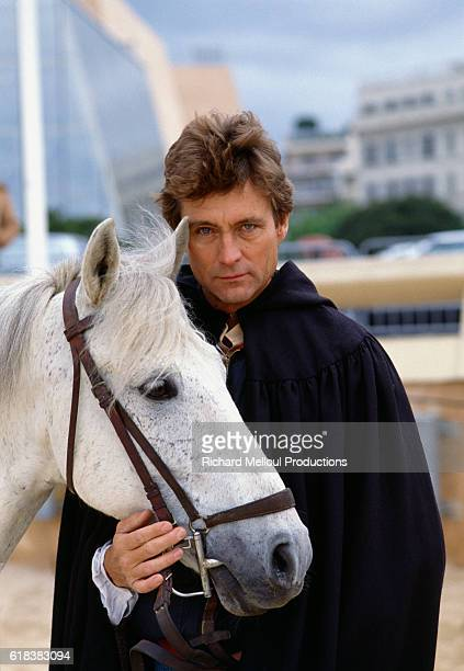 American actor John Phillip Law stands with a horse while in Cannes France for the 1984 Cannes Film Festival