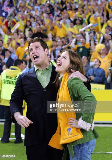 American actor John Travolta and his wife, Kelly Preston , watch the Australian Socceroos defeat Uruguay in the FIFA World Cup qualifier at Stadium...
