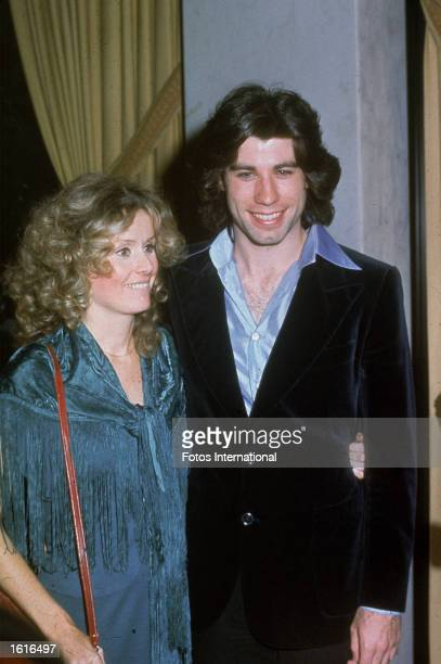 American actor John Travolta poses with his girlfriend Dianna Hyland at the Golden Apple Awards, 1976.
