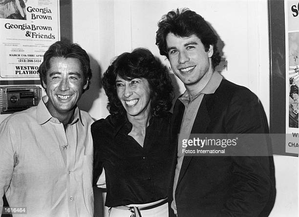 American actor John Travolta poses with his sister Ellen Travolta and his brother Sam Travolta backstage at the Westwood Playhouse where Sam was...