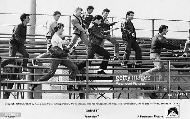 American actor John Travolta with his crew on the bleachers in the 'Summer Nights' scene from the Paramount musical 'Grease' 1978