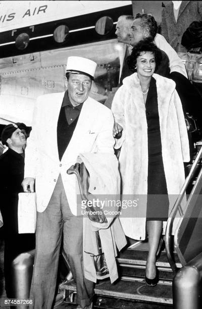 American actor John Wayne 91907 1979 and Italian actress Sophia Loren at Ciampino Airport returning from a trip from Africa where they went for the...