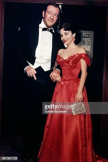 American actor John Wayne and his third wife Pilar Palette Wayne