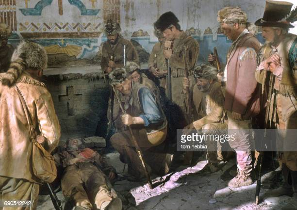 American actor John Wayne and unidentified cast members in a scene from their film 'The Alamo' Brackettville Texas 1960