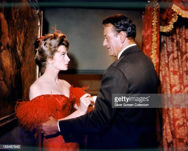 American actor John Wayne as Sam McCord and French actress Capucine as Michelle 'Angel' Bonet in 'North To Alaska' directed by Henry Hathaway and...