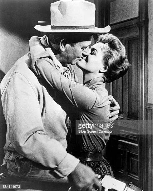 American actor John Wayne as Sheriff John T Chance and Angie Dickinson as Feathers in the film 'Rio Bravo' 1959
