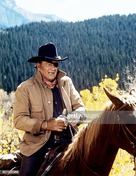 American actor John Wayne on the set of True Grit based on the novel by Charles Portis and directed by Henry Hathaway