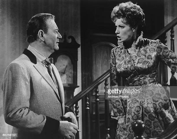 American actor John Wayne plays the lead character in the film 'McLintock' alongside Maureen O'Hara as his estranged wife 1963