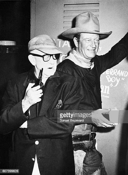 American actor John Wayne with director and producer John Ford on the set of his movie The Man Who Shot Liberty Valance