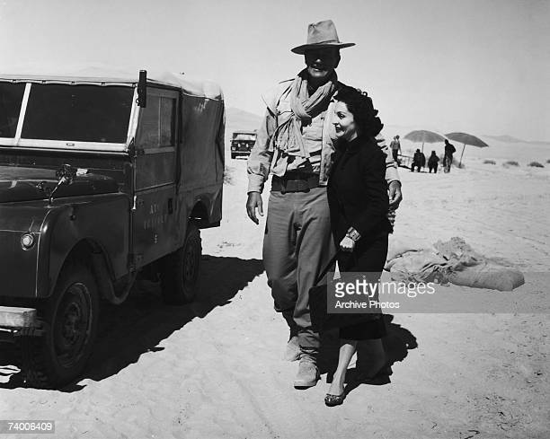American actor John Wayne with his wife Pilar during a location shoot in Libya for the film 'Legend of the Lost' 1957
