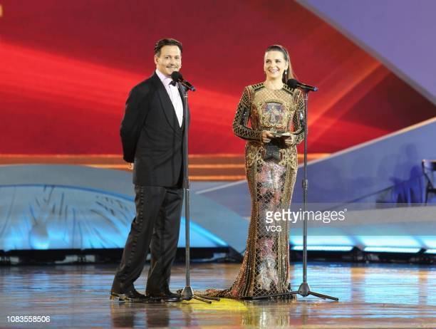 American actor Johnny Depp and French actress Juliette Binoche are seen onstage during the closing ceremony of 1st Hainan International Film Festival...
