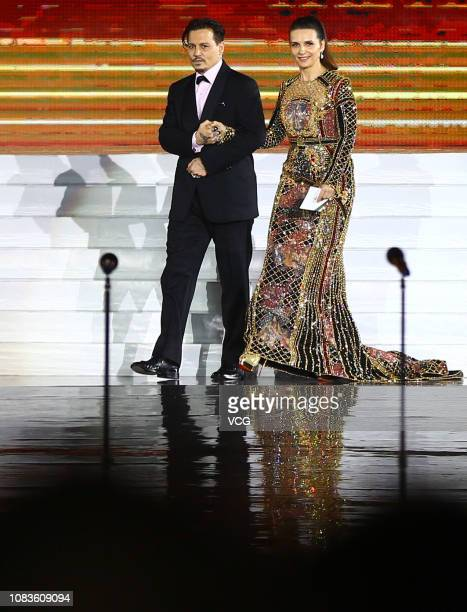 American actor Johnny Depp and French actress Juliette Binoche attend the closing ceremony of 1st Hainan International Film Festival on December 16...
