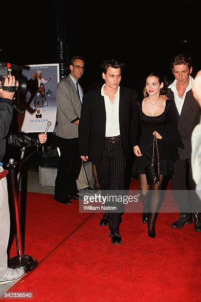 American actor Johnny Depp and his partner actress Winona Ryder attend the premiere of the movie Mermaids directed by Richard Benjamin