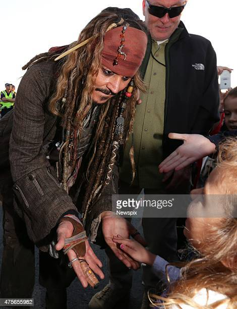 American actor Johnny Depp dressed as 'Captain Jack Sparrow' greets locals at Cleveland in Redland City Queensland after a day of filming 'Pirates of...