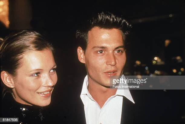 American actor Johnny Depp with his girlfriend British model Kate Moss at the 52nd Annual Golden Globe Awards held at the Beverly Hilton Hotel...
