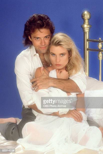 American actor Joseph Gian and Britishborn actress Nicollette Sheridan pose on a bed in a publicity portrait for the TV soap opera series 'Knots...