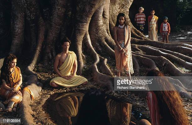 American actor Keanu Reeves stars as Siddhartha Gautama who later became known as the Buddha in the film 'Little Buddha' circa 1992 Here he films the...