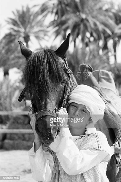 American actor Kelly Reno on the set of The Black Stallion Returns directed by Robert Dalva
