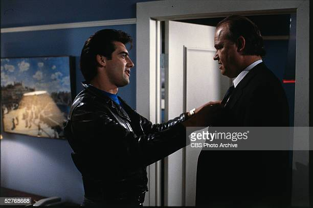 American actor Ken Wahl straightens the tie of guest star Fred Thompson in a scene from the television series 'Wiseguy' 1987 Thompson would go on to...