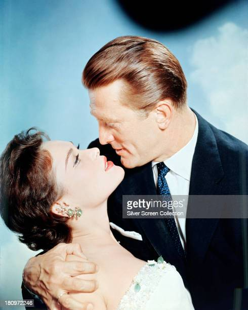 American actor Kirk Douglas and French-American actress Bella Darvi in a promotional portrait for 'The Racers', directed by Henry Hathaway, 1955.