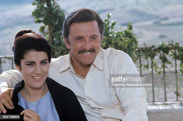 American actor Kirk Douglas and Greek actress Irene Papas taking a break on the set of The Brotherhood Italy 1968