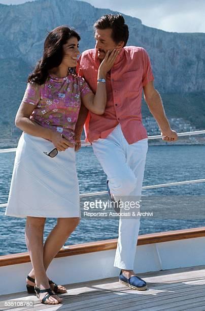 American actor Kirk Douglas and Greek actress Irene Papas taking a break on the set of The Brotherhood Italy 1968